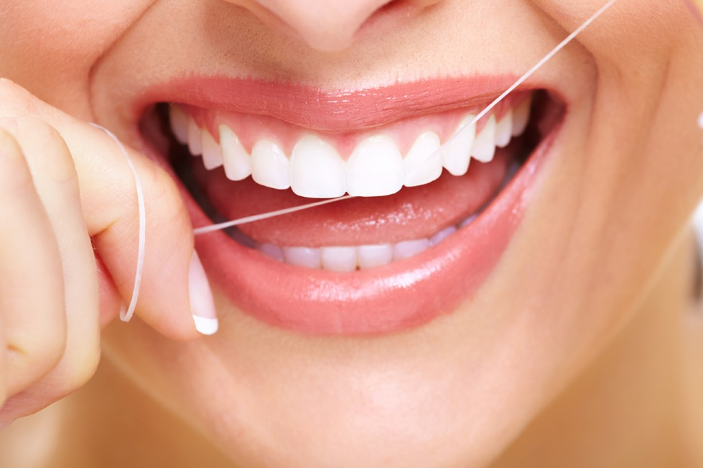 Floss regularly and properly